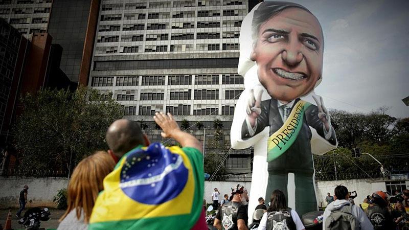 Президента Бразилии Жаир Болсонару прозвали «тропическим Трампом» из-за его нескрываемого восхищения американским лидером.