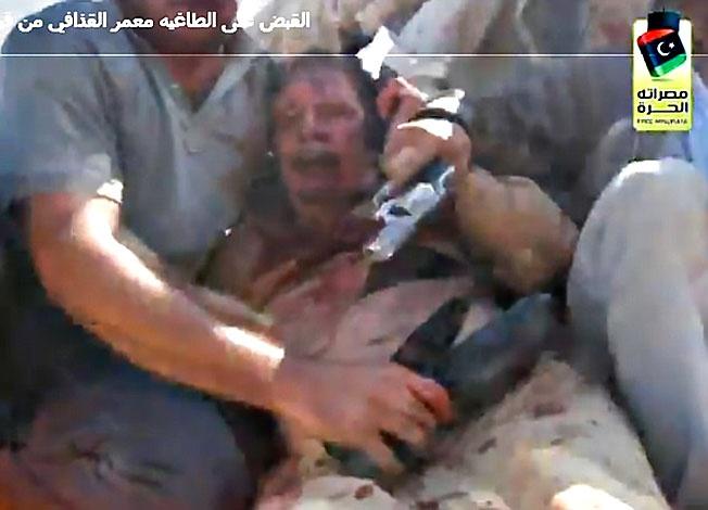 Кровавая расправа над Муаммаром Каддафи - в книге «рекордов» Обамы.