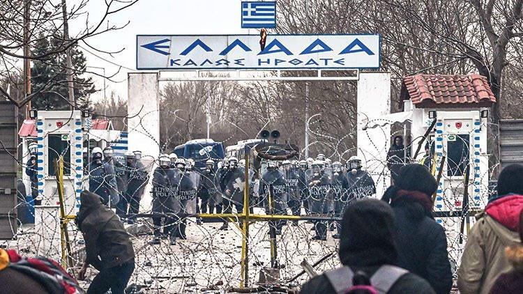 Греческая граница - колючая проволока и пограничники с оружием.