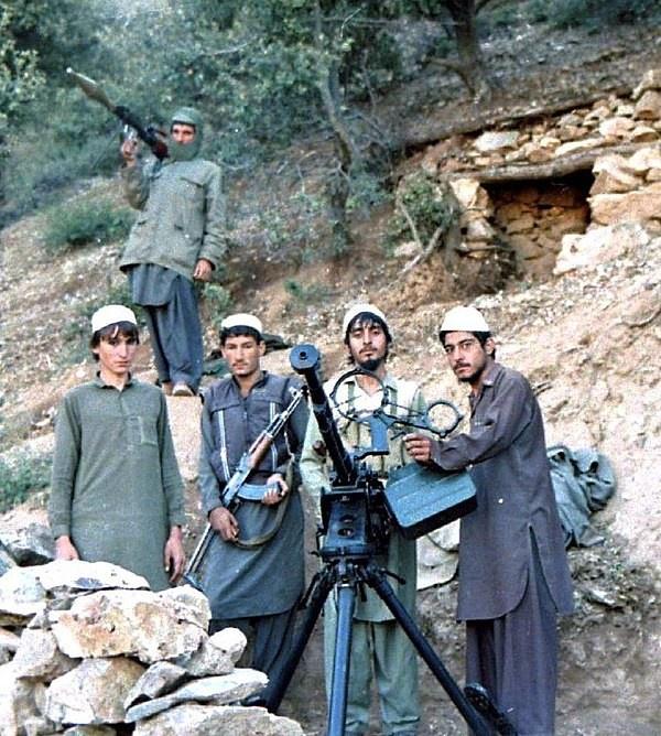 Моджахеды ИОА, вооружённые ДШК, АКМС и РПГ-7. 1987 год.
