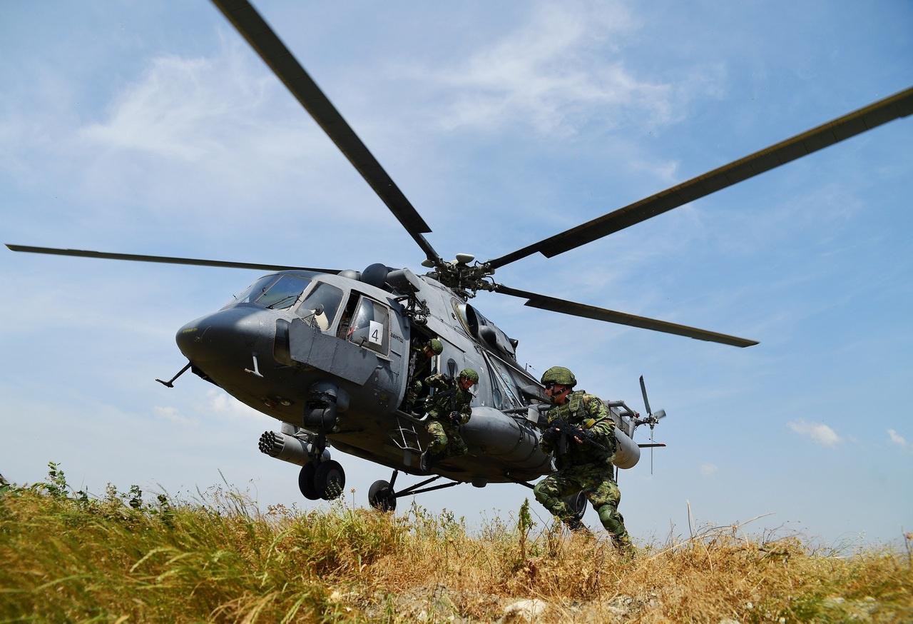 В вертолётном десанте.
