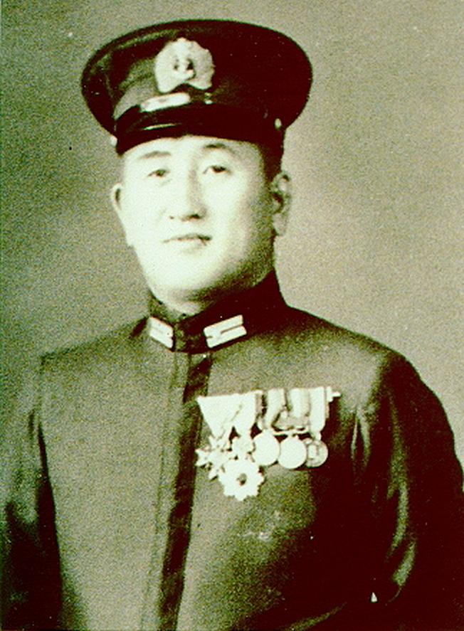 Командир I-52 Камео Уно