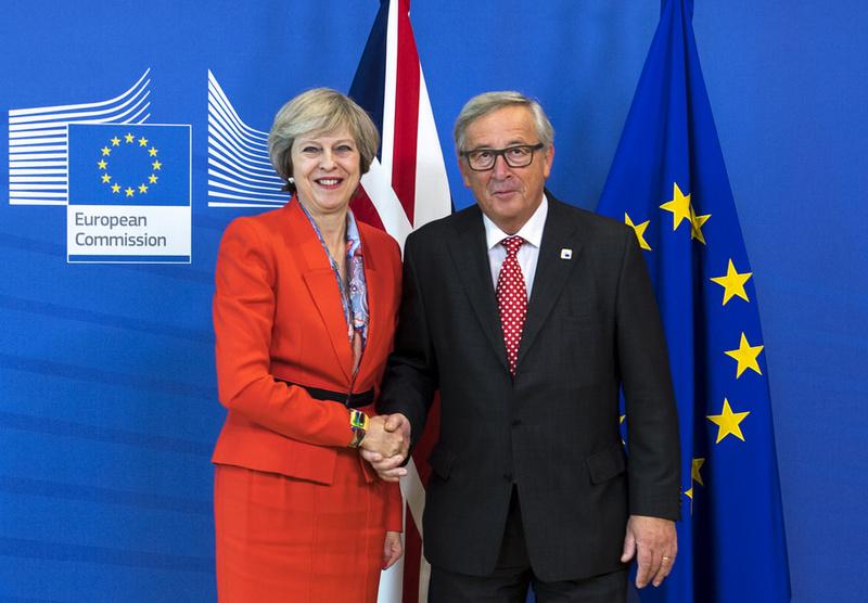 Британский премьер-министр Тереза Мэй и Председатель Европейской комиссии Жан-Клод Юнкер