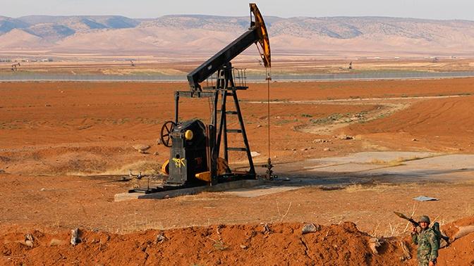 «Грабеж нефтяных ресурсов»: политолог назвал главную цель Трампа в Сирии