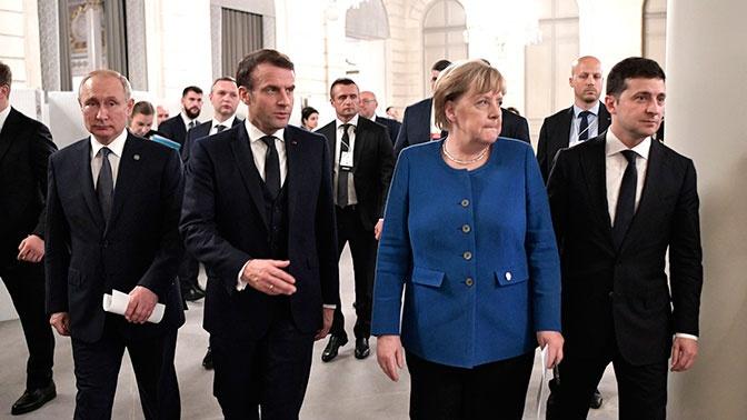 СМИ: Меркель назвала Путина «победителем» на саммите в Париже