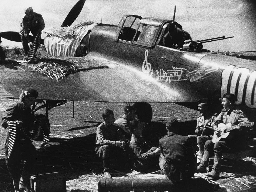 Musician turned pilot, Captain Sidorenko, with his Ilyushin IL-2.