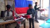 Под огнем минометов: почему бизнес по пошиву флагов Сирии не закрылся даже во время войны